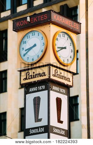 Riga, Latvia - July 2, 2016: Laima Clock was erected by the Social Democrats in 1924 to help workers to get to work on time. Now it is one of landmarks and an advert for the Laima chocolate company