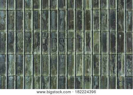 Historical copper roof with green verdigris. Background verdigris texture.