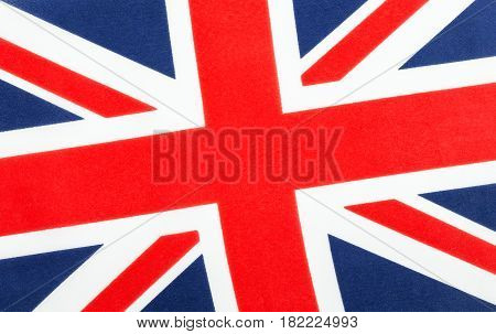 United Kingdom of Great Britain and Ireland Union Jack flag slightly tilted. Cloth red white and blue flag background.
