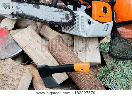 Gasoline driven chain saw on a wooden stack