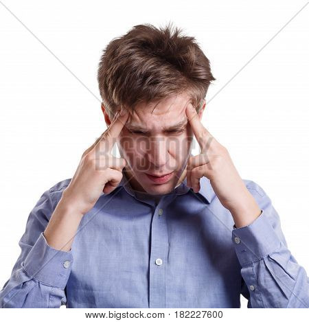 Feeling exhausted. Man suffering from headache, holding hands on temples on white isolated studio background