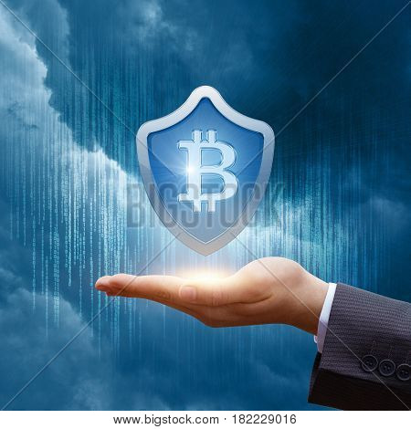 Shield With Bitcoin In Businessman Hand.