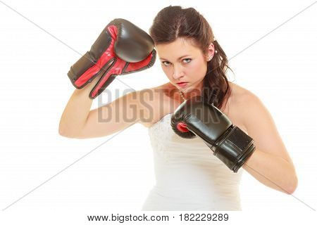 Violence in relationship concept. Dominant bide wearing wedding dress and boxing gloves