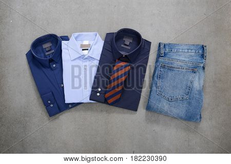 Men shirt with jeans, on gray background