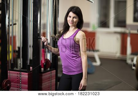 Modern young business woman exercising on a fitness machine in a fitness class at the fitness center