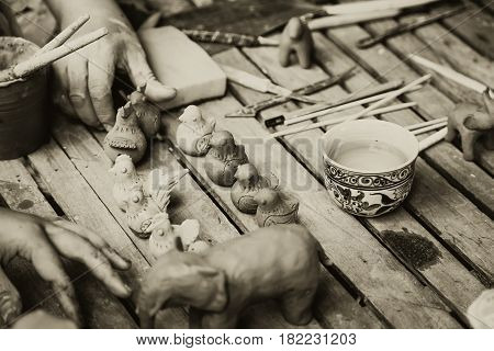 Asian Clay Sculpture Artist heritage traditional art culture of antique earthware made by senior professional hand craft in Sukhothai Thailand