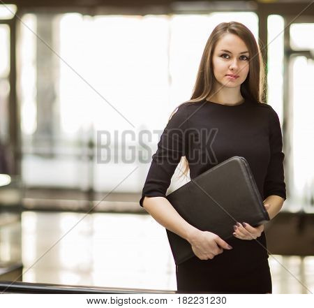 business woman with documents on the background of a spacious office.photo has empty space for your text
