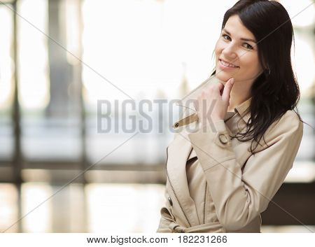 Successful business woman on a background of a spacious office.photo has empty space for your text