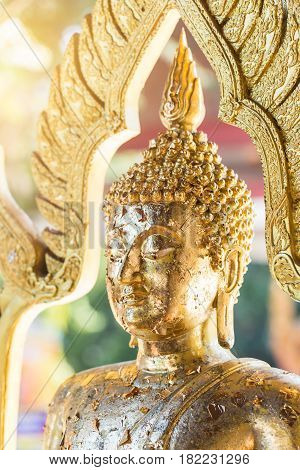Heart of Thailand. Closeup Golden Buddha head with gold gild from worship Thai Buddhist