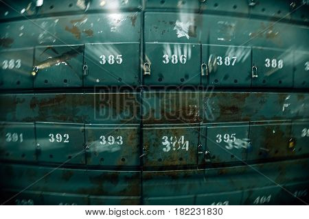 Scattered mailboxes with apartment numbers, fisheye effect, blur effect, double exposure