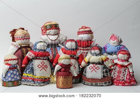 Bereginya dolls - group of handmade dolls on a white background, Old Slavic amulet in ancient Slavic clothes, Traditional Slavic rag doll