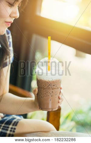 Asian Cute Teen Woman Drinking Ice Cool Milk Chocolate Or Cocoa At Summer Season In Hot Day For Heal