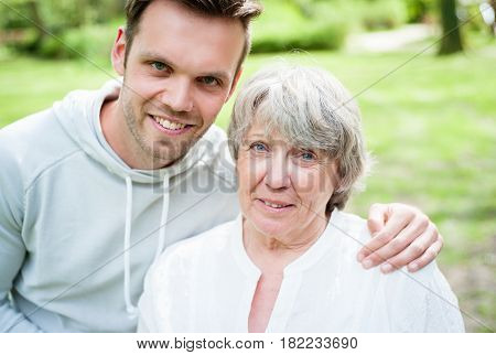 Senior woman with her grandson outside in park
