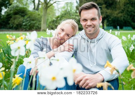 Romantic couple on flower meadow