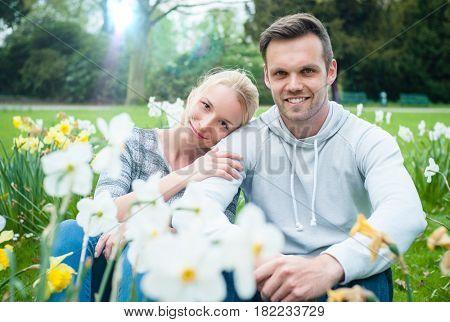Romantic couple on flower meadow