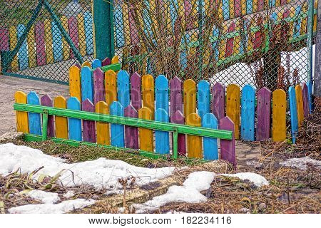 Small colored fence along the road in the Park