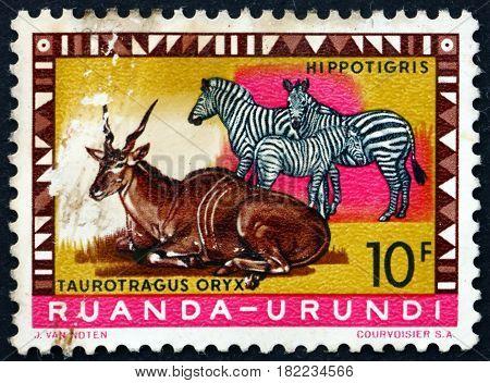 RUANDA-URUNDI - CIRCA 1959: a stamp printed in Ruanda-Urundi shows Eland and Zebras circa 1959