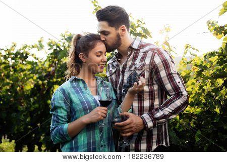 Happy couple in love in vineyard before harvesting