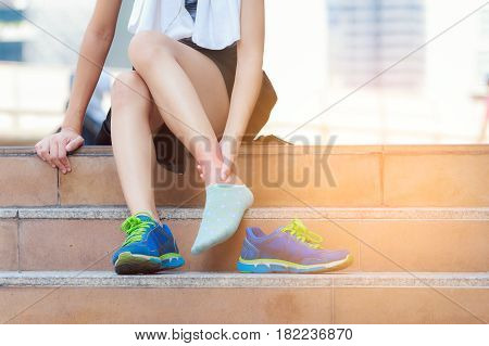 Sport Injury ,young Fitness Woman Holding Her Ankle With Pain