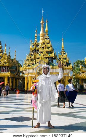 YANGON, MYANMAR-MARCH 2, 2017:  Buddhist guide at Shwedagon Paya pagoda on March 2, 2017 in Yangon. Myanmar. (Burama)