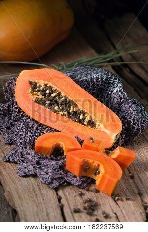 Papaya on wooden background. Sliced of papaya. Ripe papaya.