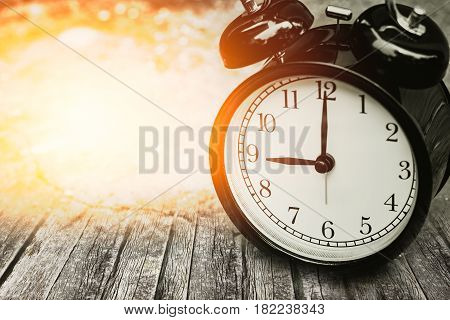 Old Memory Time Concept, Retro Clock Timed At 9 O'clock On Wood With Sun Light.