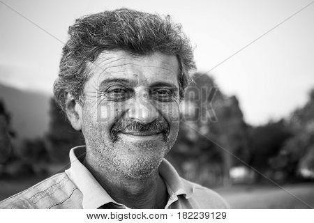 Close up portrait of mature armenian peasant on natural background