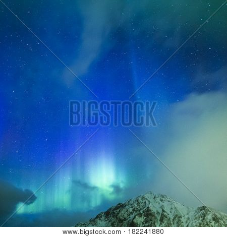 Amazing Picturesque Unique Nothern Lights Aurora Borealis Over Lofoten Islands in Nothern Part of Norway. Over the Polar Circle. Square Image Orientation