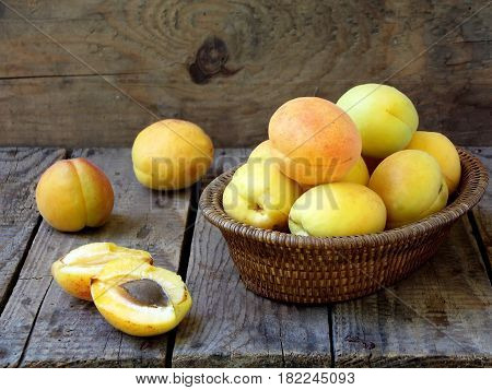 Apricots In A Basket On A Wooden Backgroun
