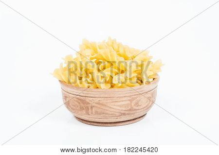 Uncooked pasta in a dish isolated on white background