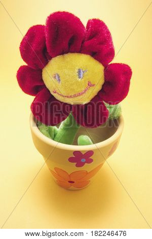 Toy Sunflower in Pot with Yellow Background