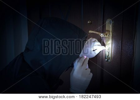 Burglar is forcing the door high quality and high resolution shoot