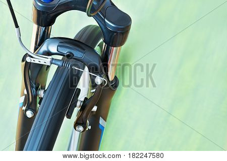 Detail Of Caliper Brakes And Suspension Fork