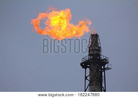 torch is lit on tower refinery - air pollution