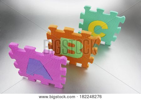 Pieces of Foam Alphabet Puzzle Mat on Seamless Background