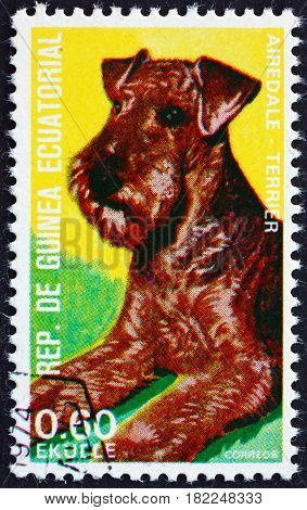 EQUATORIAL GUINEA - CIRCA 1977: a stamp printed in Equatorial Guinea shows Airedale Terrier Canis Lupus Familiaris Pet circa 1977
