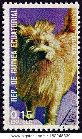 EQUATORIAL GUINEA - CIRCA 1977: a stamp printed in Equatorial Guinea shows Cairn Terrier Canis Lupus Familiaris Pet circa 1977