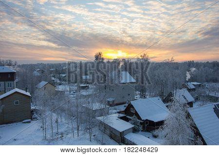 Sunset over the village in Leningrad region Russia