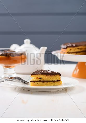 White faience teaware low callorie pumpkin dessert and layered pumpkin cake with chocolate ganache with copy space