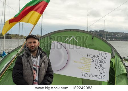 CARDIFF UK - APRIL 14 2017 Imam Sis conducting hunger strike outside Senedd. Protest by Kurdish Solidarity Wales in support of polital prisoners jailed in Turkey by National Assembly of Wales