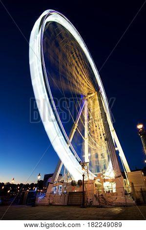 Big luminous ferris wheel in Paris, France