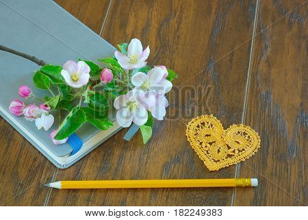 Spring flower bloom pencil and lyrics diary. Romantic message notebook. Greeting love writing symbol.