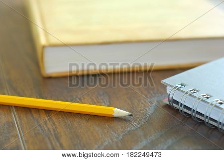 Pencil book notebook student study accesories. Education stationary closeup. Drawing pencil on desk home workplace.