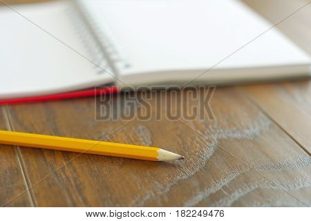 Yellow pencil memo notes organizer. Open notebook memories reminder. Education stationary closeup.