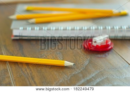 Education study kit. Pencils notepaper on workplace. Personal notes reminder. Idea organizer closeup. Working place stationary.
