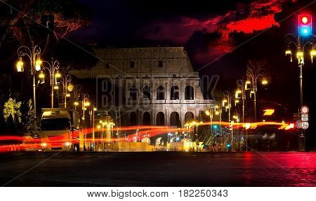 Colosseum and beautiful sky at night in Rome, Italy