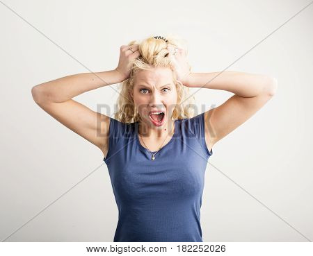 Angry woman pulling her hair out in anger