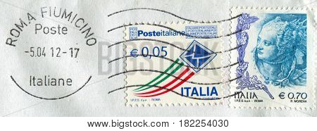 GOMEL, BELARUS, APRIL 18, 2017. Stamp printed in Italia shows image of  The Post envelope and Engraved woman, circa 2012.