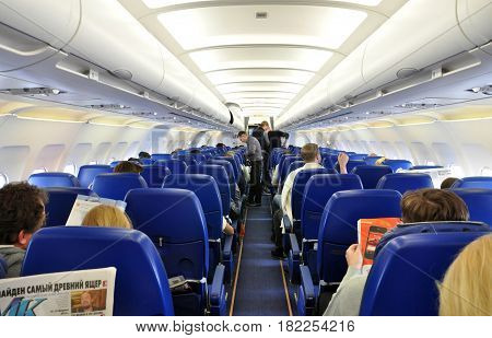 Passengers Waiting In A Boeing Airplane To An Intercontinental Flight