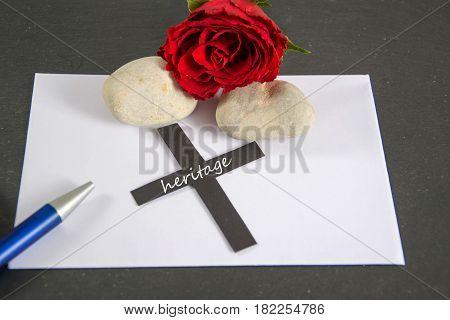 heritage - written on a black cross